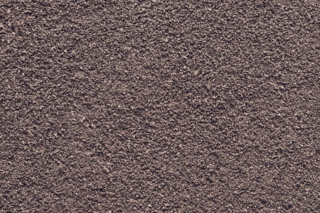 texture of powder of ground coffee of brown color for an abstract background photo