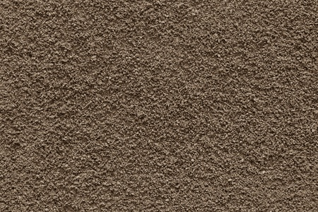 texture of powder of ground coffee of chocolate color for an abstract background photo