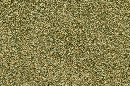 texture of the crushed powder of yellow green color for an abstract background photo