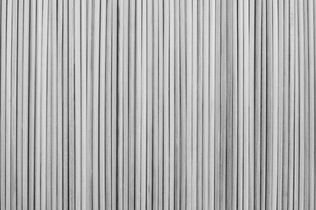laths: the abstract textured background from wooden vertical bars of gray color