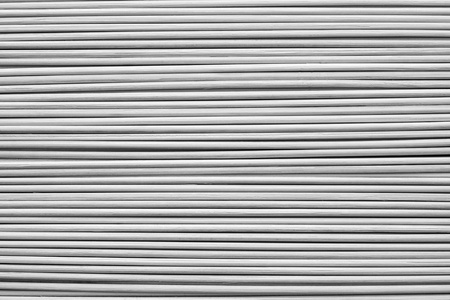 ashy: the abstract textured background from wooden horizontal rods of ashy color Stock Photo