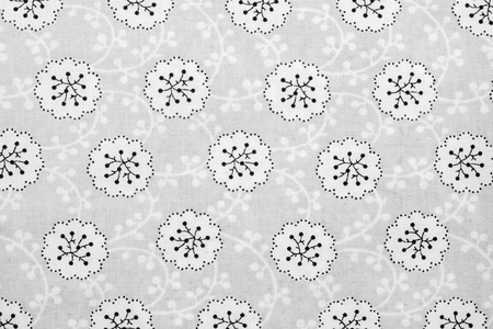 florets: the textured background of cotton fabric of gray color with a pattern from abstract florets Stock Photo
