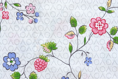 textile image: textured background with the abstract image of flowers and berries on cotton textile fabric