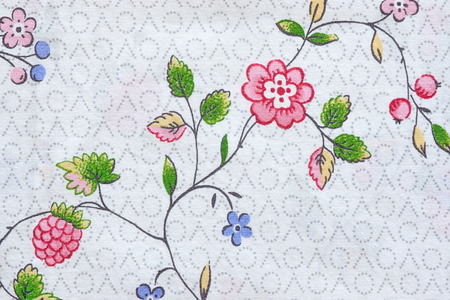 textile image: abstract pattern with the image of flowers and berries on textile fabric for backgrounds