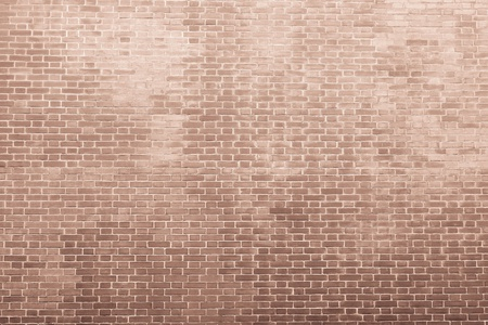texture of an old bricklaying in light brown tones for abstract backgrounds and for wallpaper photo