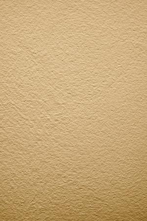 抽象的なテクスチャ背景のベージュ塗装漆喰表面