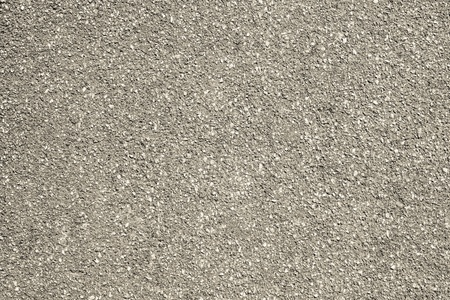 granular: rough granular texture of an old asphalt surface for abstract beige backgrounds with impregnations