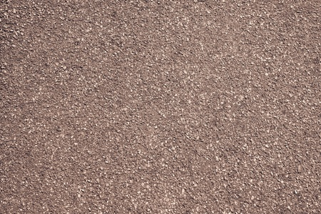 granular: rough granular texture of an old asphalt surface for abstract brown backgrounds with impregnations