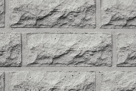 the rough textured concrete wall closeup for abstract backgrounds of gray color photo