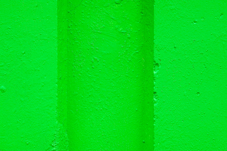 hollow wall: abstract relief of a hollow and ledges on a concrete wall for textural backgrounds of bright green color Stock Photo