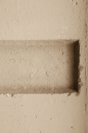 hollow wall: abstract relief of a hollow and ledges on a concrete wall for textural backgrounds of beige color Stock Photo