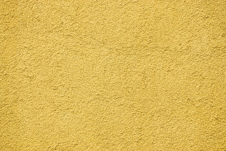 scabrous: abstract texture of a rough scabrous concrete surface for painted backgrounds of yellow color