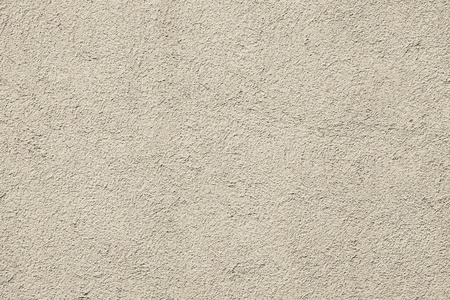 scabrous: abstract texture of a rough scabrous concrete surface for painted backgrounds of beige color