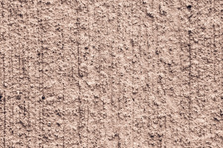 mottle: texture of a rough rough concrete wall with cracks for abstract backgrounds of terracotta brown color