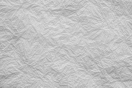 abstract texture of the crumpled thin paper napkin for backgrounds of white color photo