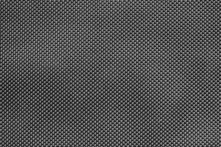 黒い色の抽象的な背景の wattled 生地の大まかなテクスチャ