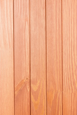 abstract texture of the painted wooden surface of pale red color photo