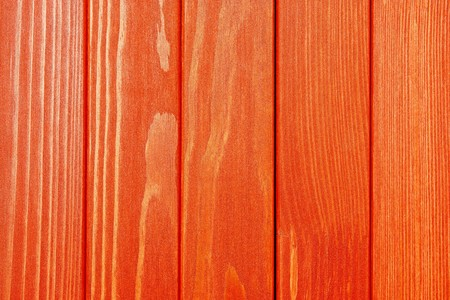 abstract texture of the painted wooden surface of red color photo