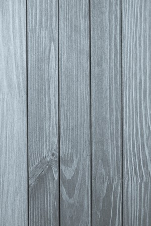 the silvery: abstract texture of the painted wooden surface of silvery color