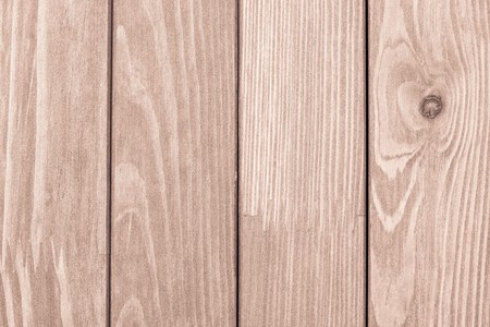 laths: abstract texture of the painted wooden surface of pale brown color