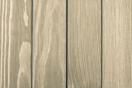 abstract texture of the painted wooden surface of beige color photo