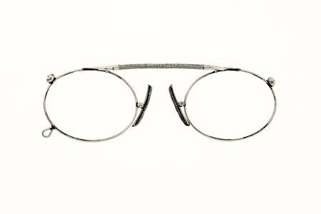 chromeplated: the isolated old eyeglasses in the chromeplated frame closeup on a white background Stock Photo
