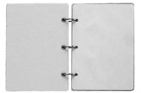 open notebook on a white background with a cover from fabric and with paper pages of gray color photo