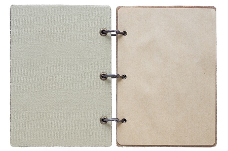 open notebook on a white background with a textile cover and with paper pages photo