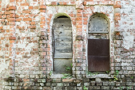 niches: brick wall of the old destroyed building with the broken window niches
