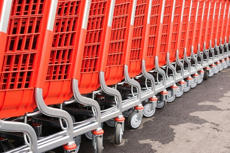 household goods: abstract parts of red baskets-carts for warehousing of food and household goods upon purchase in shops and in markets