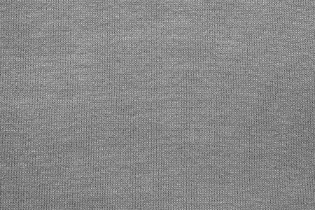tejido de lana: extracto de la textura de la tela de punto o tejido en forma de espina de pescado para los fondos de color de negro Foto de archivo