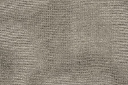 textiles texture: abstract texture of the knitted fabric or woven in the form of herringbone for backgrounds of beige gray color