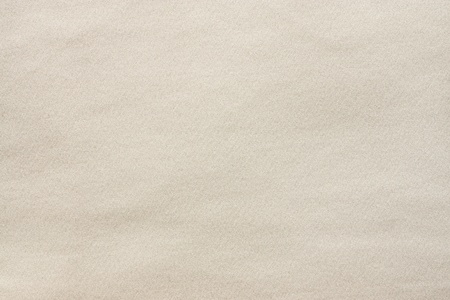 the textured background from synthetic smooth fabric of light tones peach color photo