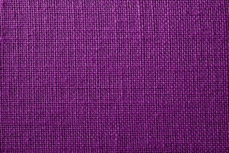 crisscross: the textured background of synthetic fabric with crisscross fibers of dark lilac color