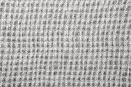the textured background of synthetic fabric with crisscross fibers of light gray color Stock fotó