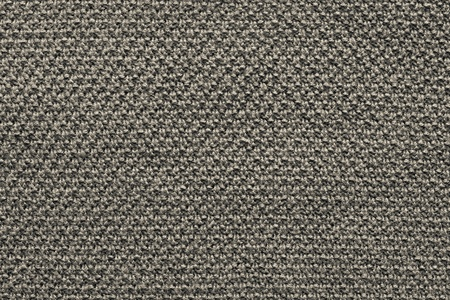 textural: abstract textural background from knitted fabric of beige color