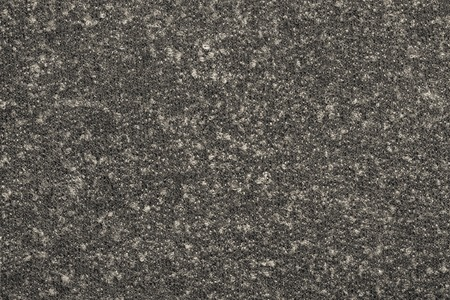 outerwear: abstract textural background from knitted fleecy synthetic fabric of dark beige-gray color for tailoring of warm outerwear