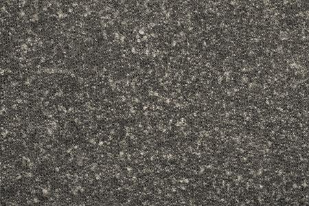 outerwear: astratto testuale da un morbido tessuto a maglia sintetico di colore beige-grigio scuro per la sartoria di abbigliamento esterno caldo Archivio Fotografico