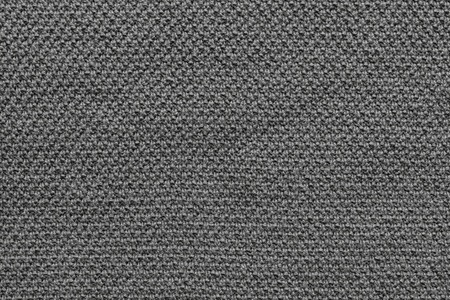 textural: abstract textural background from knitted fabric of black color