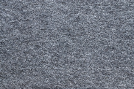 textural: abstract textural background from soft fleecy knitted fabric  of gray color