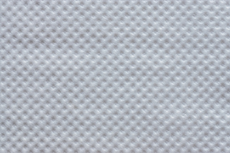 corrugation: the wafer textured surface of a paper napkin with shades of white and gray color for abstract festive backgrounds and for wallpaper