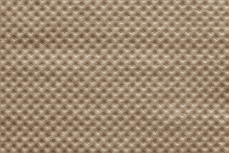 corrugation: the wafer textured surface of a paper napkin of brown color for abstract festive backgrounds and for wallpaper