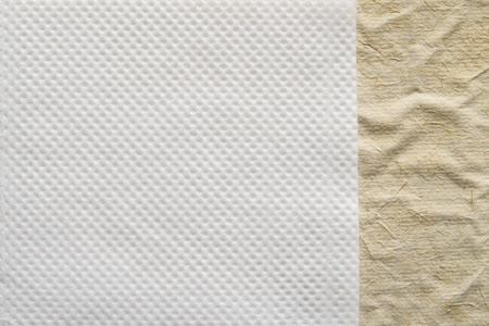 corrugation: combination of two paper textures from a soft napkin of white color and the rough crumpled surface for abstract backgrounds