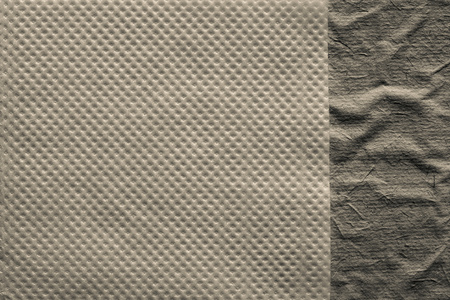 corrugation: combination of two paper textures from a soft napkin of beige color and the rough crumpled surface for abstract backgrounds Stock Photo
