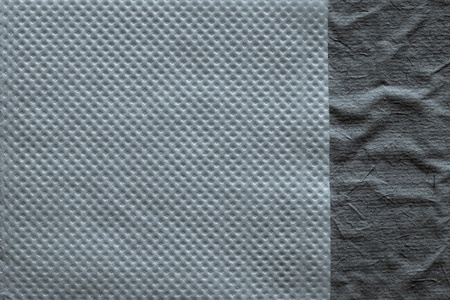 corrugation: combination of two paper textures from a soft napkin of silvery color and the rough crumpled surface for abstract backgrounds Stock Photo