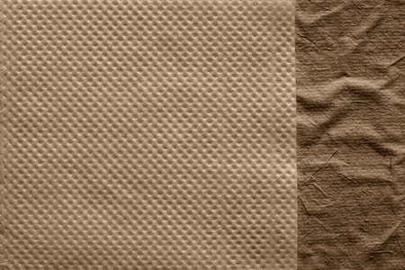 corrugation: combination of two paper textures from a soft napkin of brown color and the rough crumpled surface for abstract backgrounds