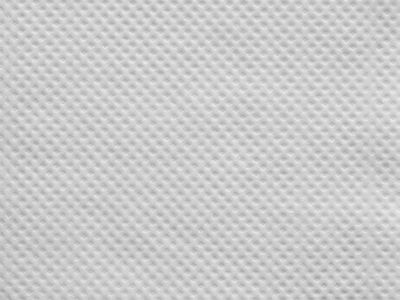 corrugation: the wafer textured surface of a paper napkin of white color for abstract festive backgrounds and for wallpaper