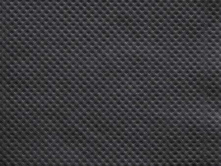 corrugation: the wafer textured surface of a paper napkin of black color for abstract festive backgrounds and for wallpaper