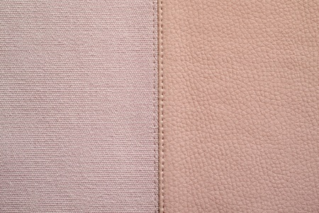 fabric textures: the stitched combination of two textures of pink color from rough fabric and an imitation leather for abstract backgrounds