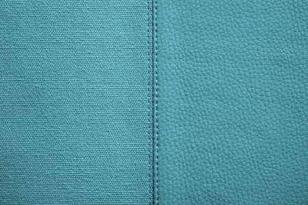 fabric textures: the stitched combination of two textures of turquoise color from rough fabric and an imitation leather for abstract and for festive backgrounds